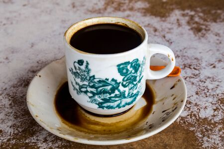 kopitiam: Traditional oriental Chinese coffee in vintage mug and saucer served in coffee shop. Stock Photo