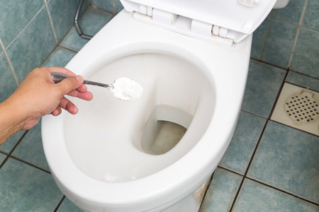 disinfect: Baking soda used to clean and disinfect bathroom and toilet bowl