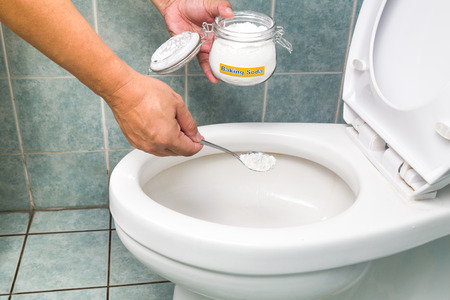 irrigator: Baking soda used to clean and disinfect bathroom and toilet bowl