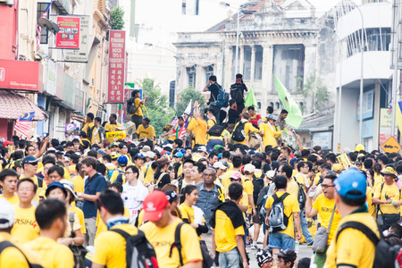 demonstrator: KUALA LUMPUR, Malaysia - August 29, 2015: The BERSIH 2.0 organized a street rally dubbed BERSIH 4 on August 29 and 30th to call for clean and transparent governance in Malaysia as well as strengthening parliamentary democracy system Editorial