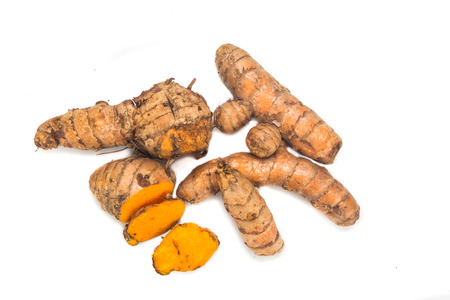 Fresh turmeric roots with healing properties on white background