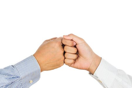 bump: Fist bump on formal wear, gesturing an agreement and cooperation
