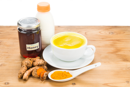 food and drink: Turmeric roots with milk and honey drinks for beauty and health