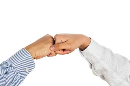 formal wear: Fist bump on formal wear, gesturing an agreement and cooperation