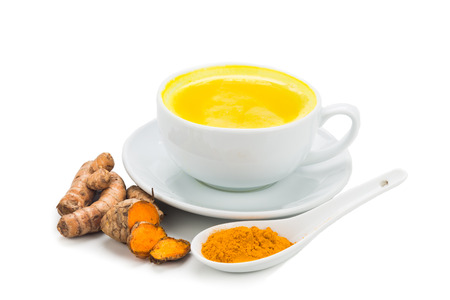 Turmeric with milk drinks good for beauty and health Banco de Imagens - 45170166