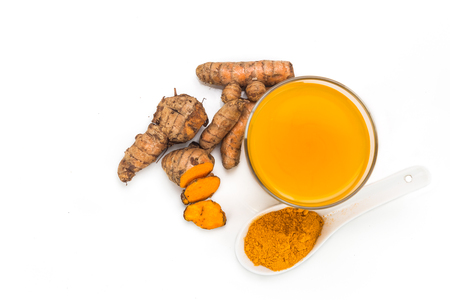 curcumin: Healthy turmeric roots drinks in a transparent glass