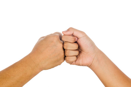 Fist bump gesturing an agreement and cooperation