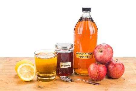 꿀, 레몬, 자연 요법 및 일반적인 건강 상태에 대한 치료와 애플 사이다 식초 스톡 콘텐츠
