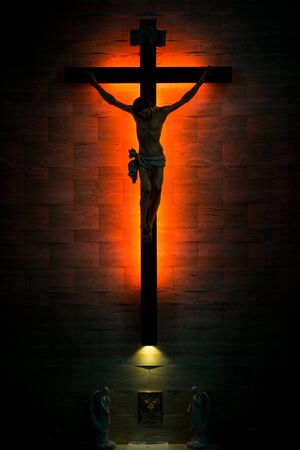 tabernacle: Catholic Christian Crucifix in silhouette, with tabernacle underneath