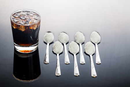 Concept of fizzy cola drinks with unhealthy sugar content. Stock Photo