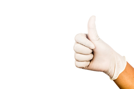 latex glove: Hand in surgical latex glove gesture Thumbs up good.
