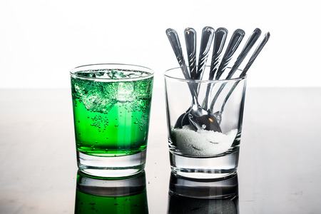 fizzy: Concept of green fizzy drinks with unhealthy sugar content. Stock Photo