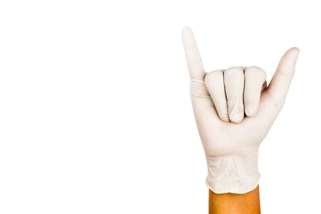 latex glove: Hand in surgical latex glove gesture number Six. Stock Photo