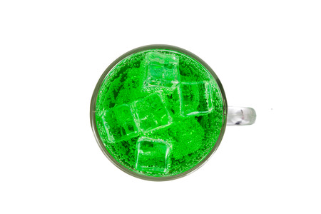 fizzy: Refreshing green fizzy soft drink with ice in transperant glass.