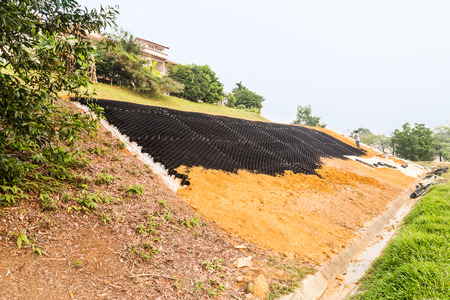 reclamation: Slope erosion control with grids and earth on steep slope.