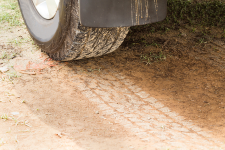 four wheel: Four wheel drive tire with tracks on dry dirt road.