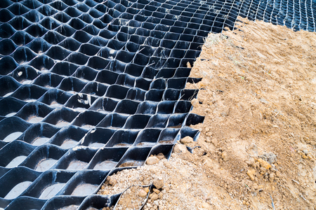 reclamation: Close up on slope erosion control grids on steep slope with earth for reclamation