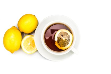 stimulate: Top down view of refreshing hot tea with lemon slice and lemon fruits on white backlit background Stock Photo