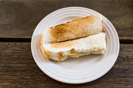 kopitiam: Traditional oriental toast  bread with butter and kaya at coffee shop.