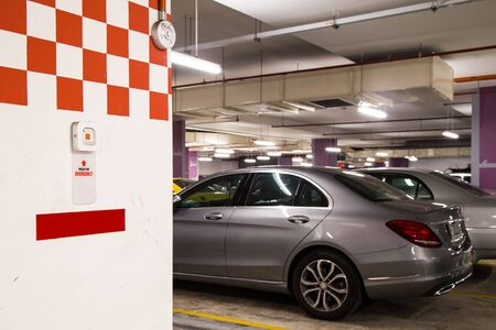 car crime: Selective focus on Emergency Alarm Panic Button at car park complex for security alert and crime control