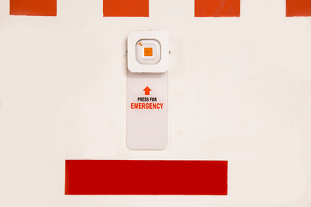 panic button: Emergency alarm panic button at car park complex for security alert and crime control Stock Photo