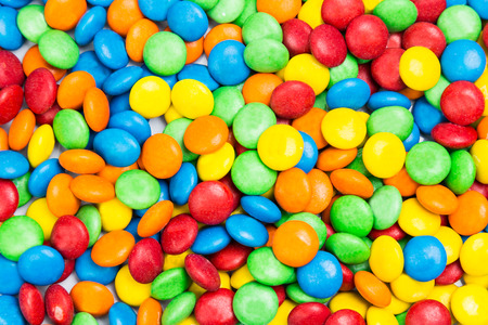 greem: Pile of delicious colorful milk chocolate candies with thin crisp shell Stock Photo