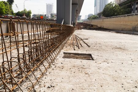 construction materials: Steel rebar and concrete divider being constructed at construction site of highway underpass
