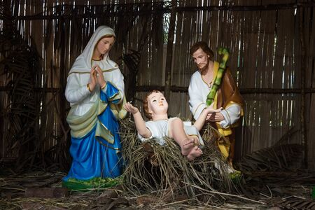 Christmas decorative creche with Holy family of Joseph, Mary and baby Jesus Christ