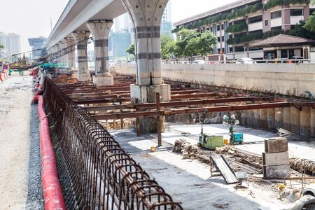 underpass: Digging and construction of tunnel underpass underway beneath train line within city setting Stock Photo