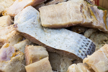 dried fish: Closeup and focus on a portion of freshy dried and preserved salted fish, a delicacy among Asians