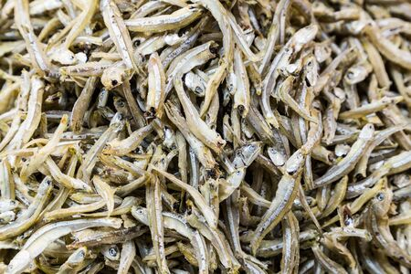 dried fish: Heap of dried and salted anchovy fish, a delicacy in Asian cooking and recipe