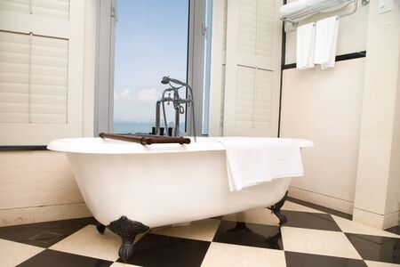 master bath: Luxury classic bathtub in bathroom with relaxing ambient and window  with scenic sea view