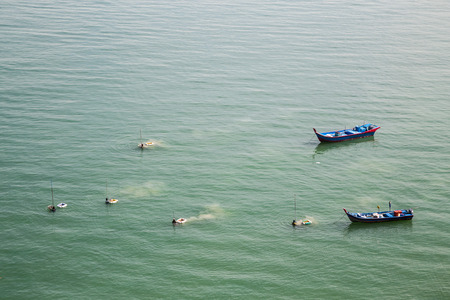 shellfish: Fishermen harvesting shellfish,  fish seafood from the sea with net Stock Photo