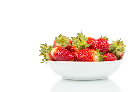 plateful: Plateful of freshly harvested organic juicy strawberries with white background