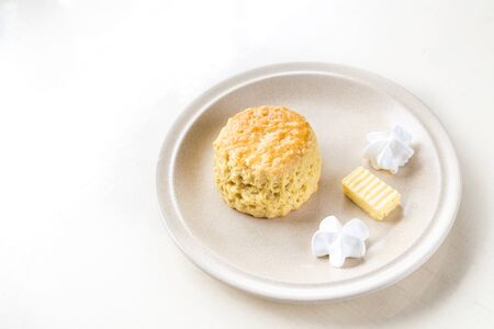 ambient light: Simple and delicious English scones set with butter and cream with ambient light