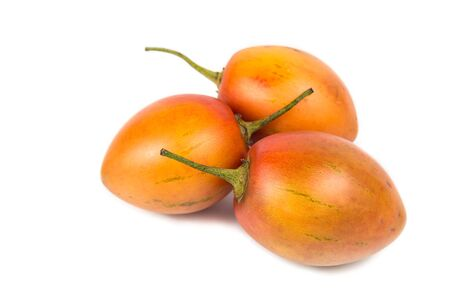 tamarillo: Fresh sweet and sour tamarillo fruits also known as tomato with white background