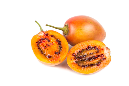 tamarillo: Sliced fresh sweet and sour tamarillo fruits also known as tomato with white background Stock Photo