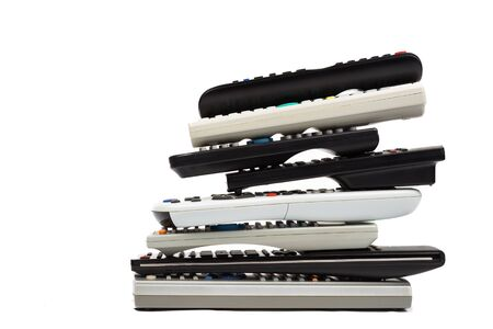remote controls: Stack of modern audio video remote wireless control device in white background