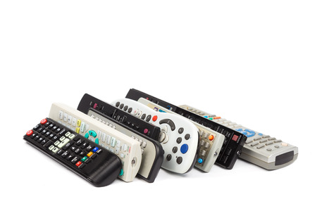 audio video: Stack of modern audio video remote wireless control device in white background