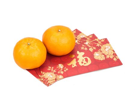 mandarin oranges: Mandarin oranges and red packets with Good Luck message in Chinese character on white background Stock Photo