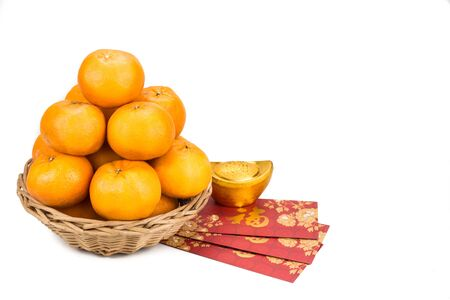 mandarin oranges: Mandarin oranges with decorative gold nugget and red packets with good luck greeting character in Chinese on white background