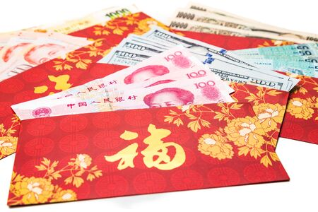 hung: Hung Bao or red packet with Good Fortune Chinese character scatted with various currency notes