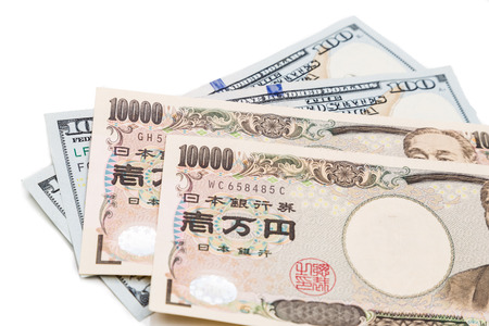 yen note: Close up of the Japanese Yen currency note against US Dollar on white background