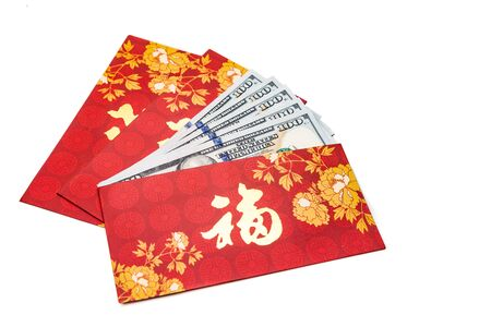 red packet: Hung Bao or red packet with Good Fortune Chinese character filled with US Dollars