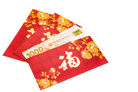 bao: Hung Bao or red packet with Good Fortune Chinese character filled with Hong Kong Dollars