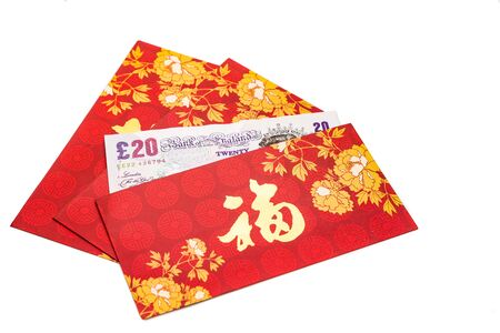 ang: Hung Bao or red packet with Good Fortune Chinese character filled with Sterling Pound currency