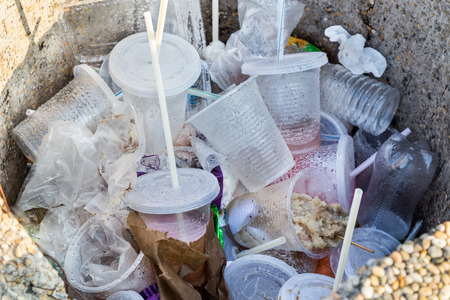 degradable: Environmental unfriendly non-biodegradable PVC containers, straws and unfinished food in rubbish bin