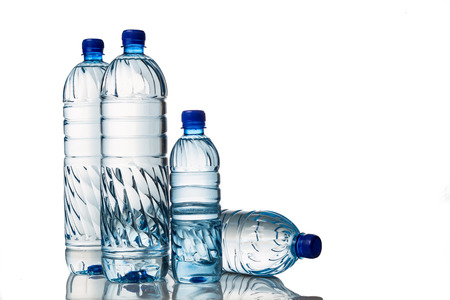 Four refreshing natural mineral water in plastic bottle in white background