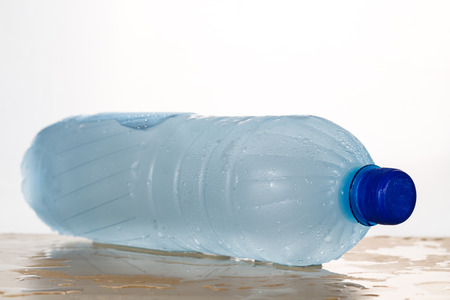 water frozen: Freezing water in PET plastic bottle provide refreshing drinks but deemed an unhealthy practice Stock Photo