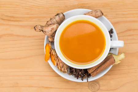 piperine: Aromatic turmeric tea with black pepper, cinnamon, cloves and ginger offers many wellness health benefits